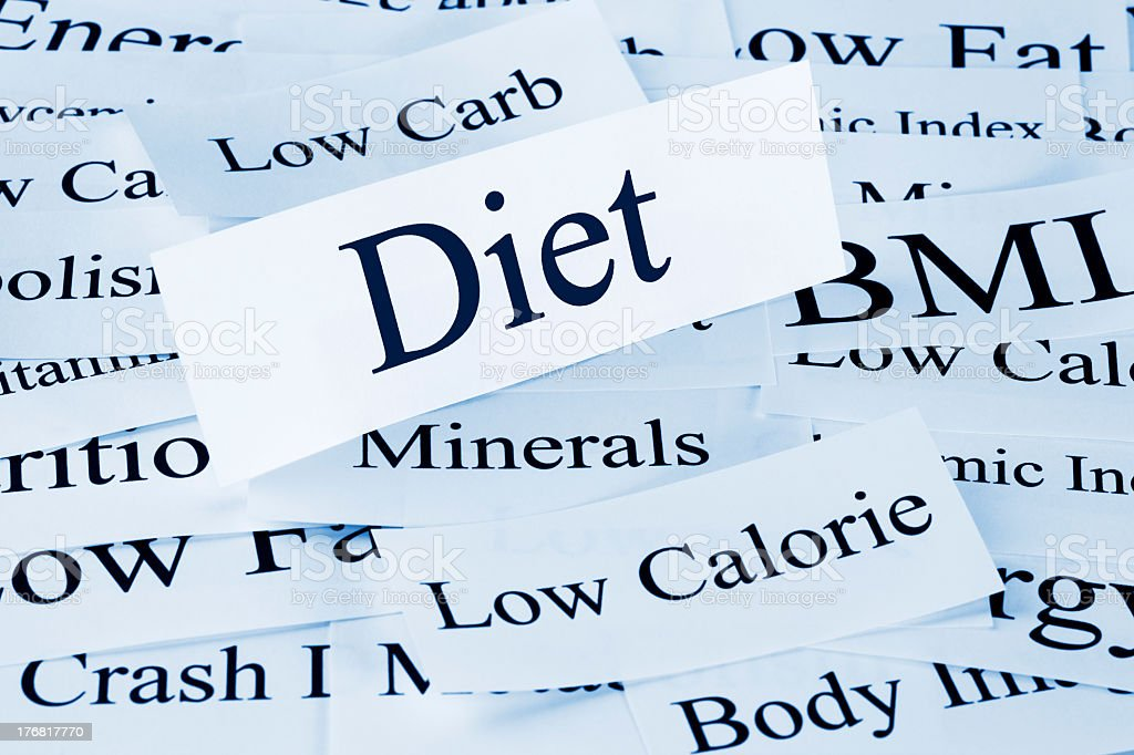 Paper cutout of the word Diet above other related words stock photo