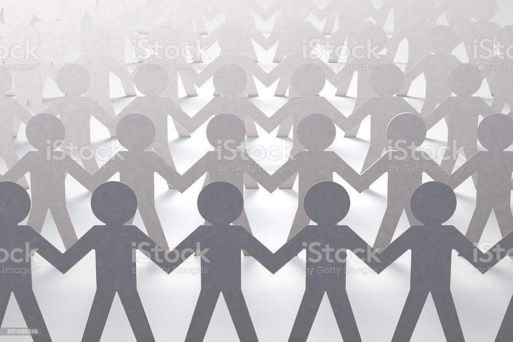 paper cutout people standing together,teamwork,cooperation concept