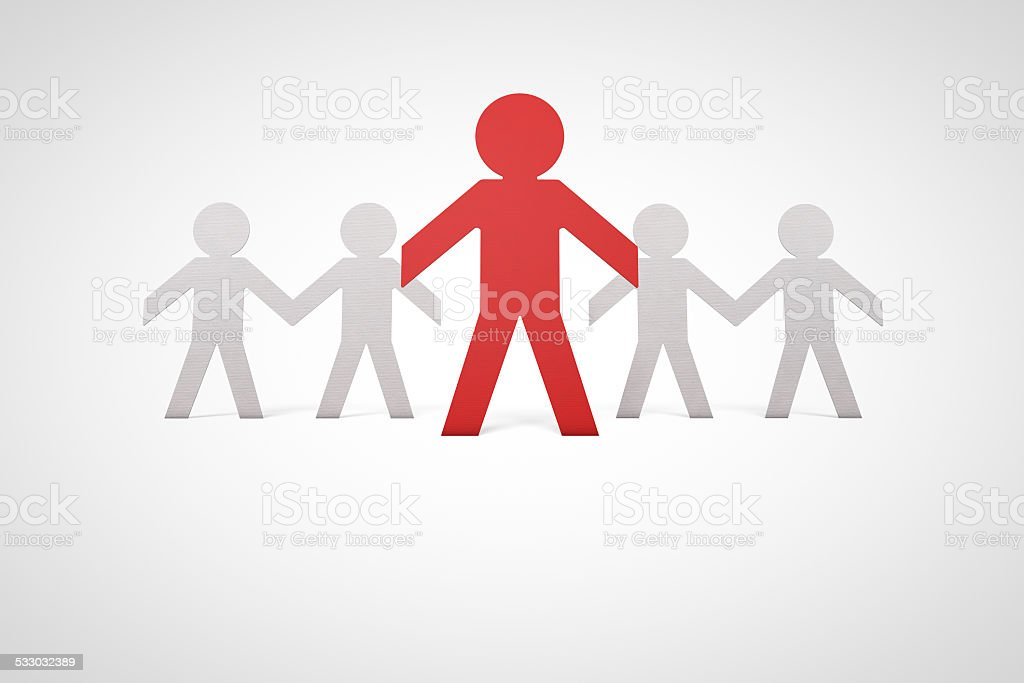 paper cutout group of people with one leader in red paper,...