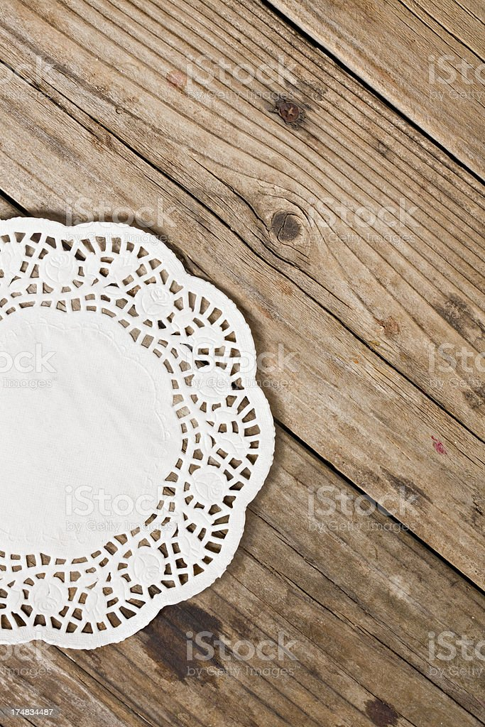 Paper Doily On An Old Table stock photo