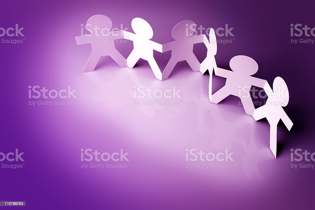 Paper doll chain team with six figures on purple background royalty-free stock photo