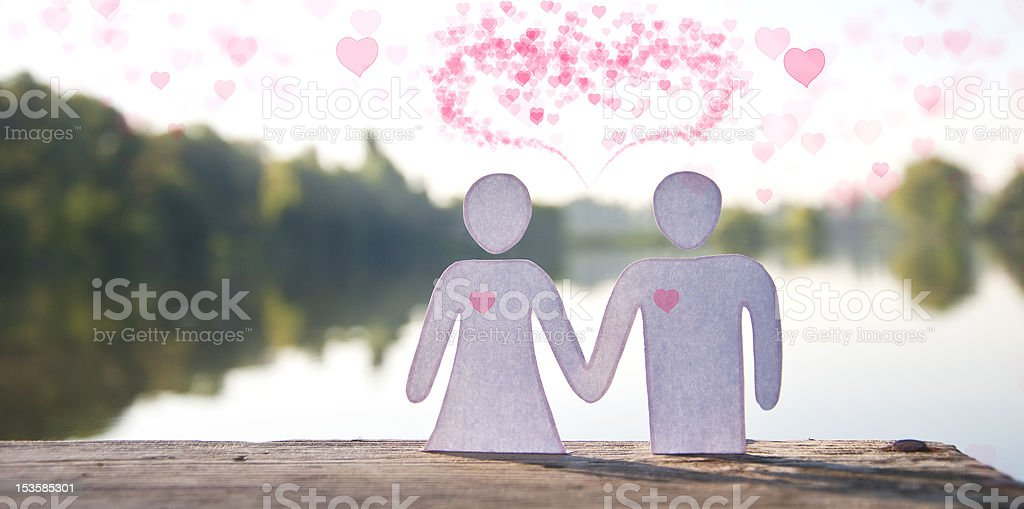 Paper doll couple holding hands royalty-free stock photo