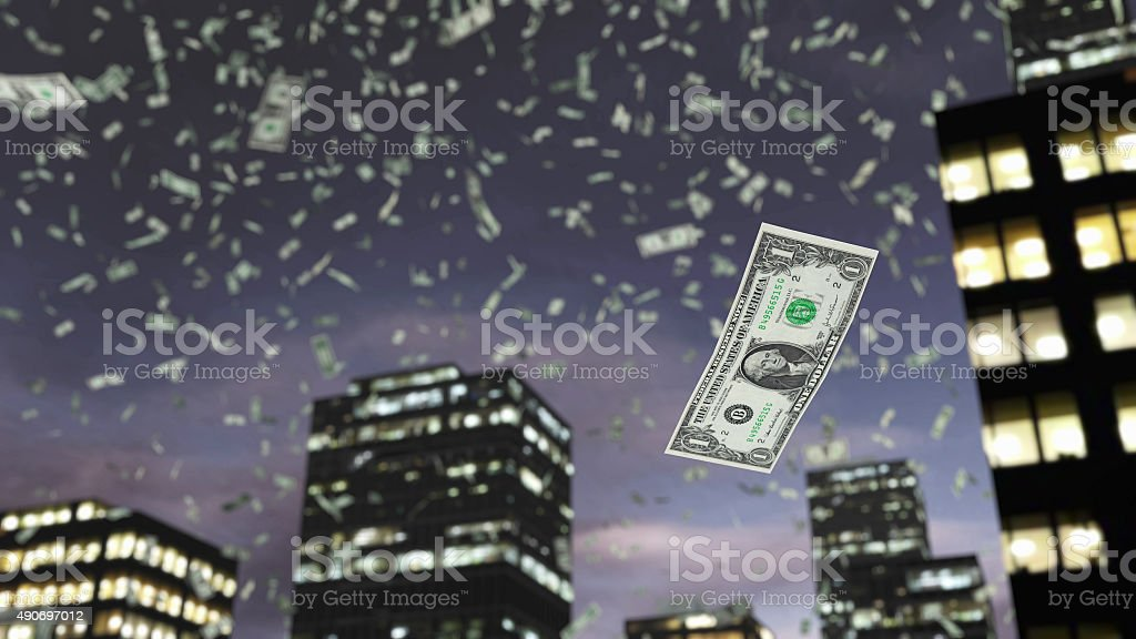 Paper dollar money fall from the sky stock photo