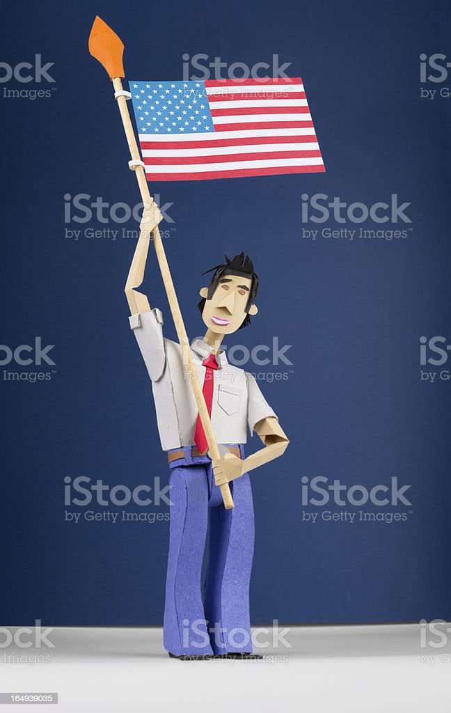 Paper Figurine Holding USA Flag royalty-free stock photo