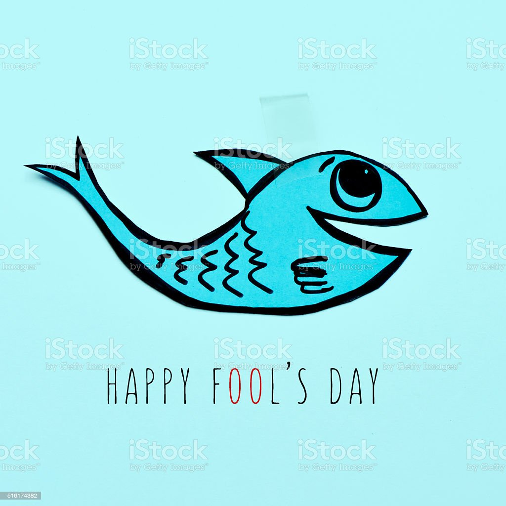 paper fish and text happy fools day stock photo