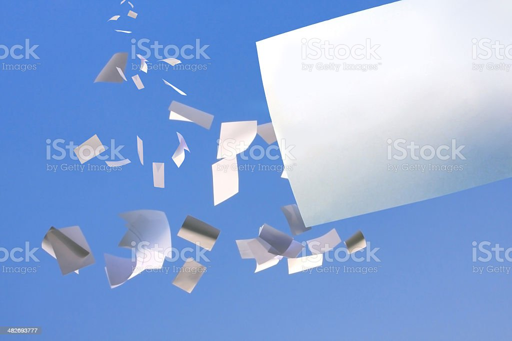 paper flying in blus sky. stock photo