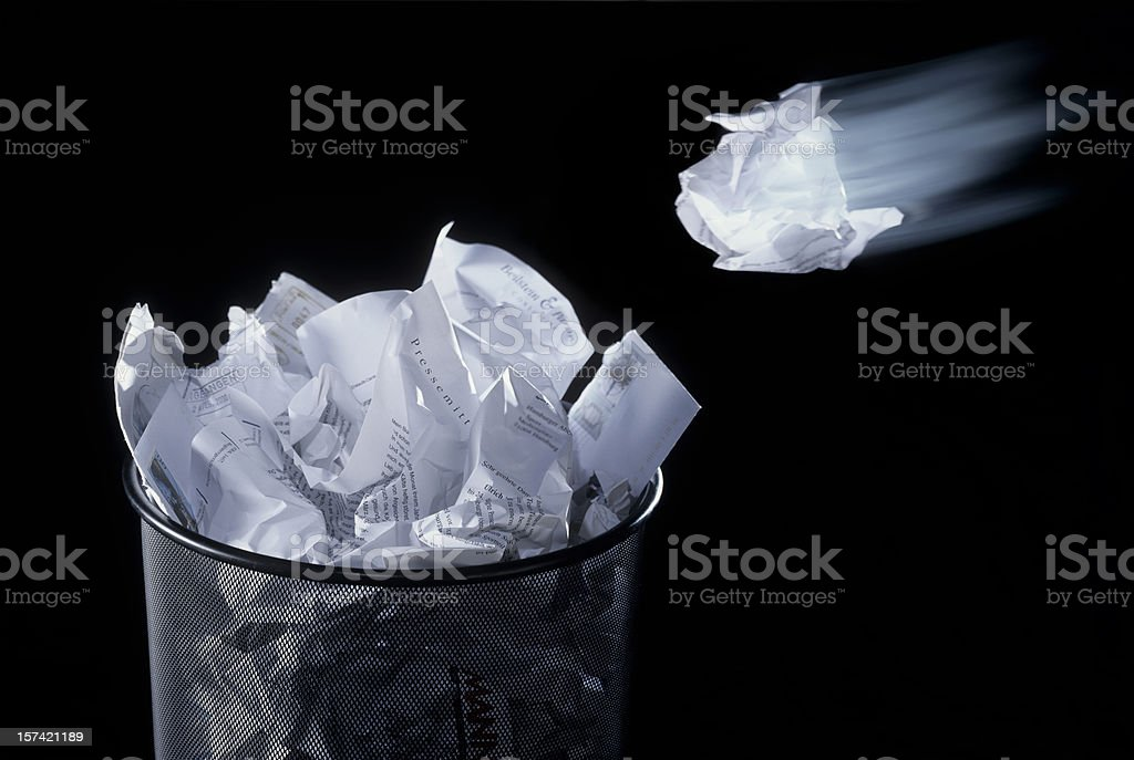 Paper flying into trash royalty-free stock photo