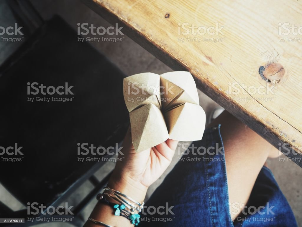Paper fortune teller oh hand stock photo