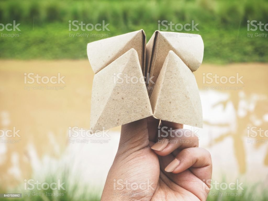 Paper fortune teller on hand stock photo