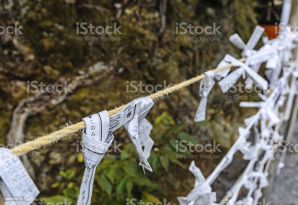 Paper fortune tied on a Rope stock photo
