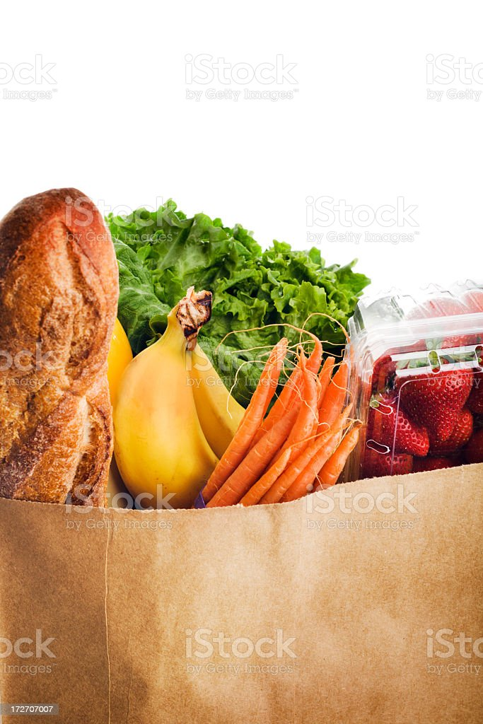 Paper Grocery Bag Holding Fresh, Healthy Foods, Fruits, Vegetables, Bread royalty-free stock photo