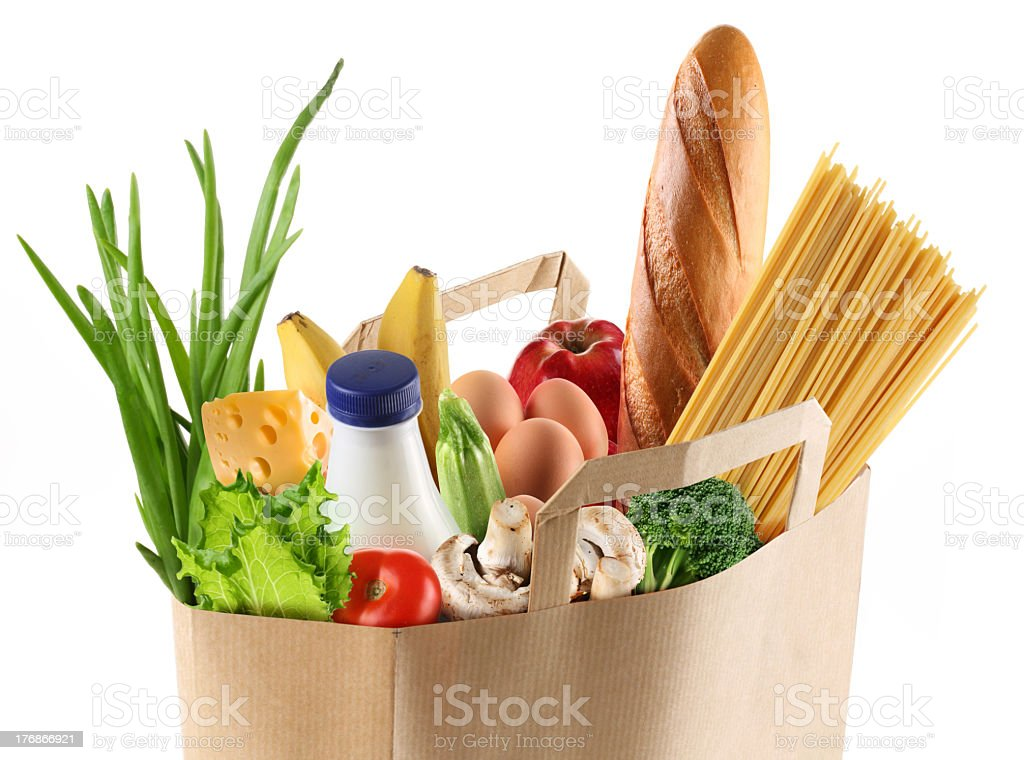 A paper grocery bag with multicolored food stock photo
