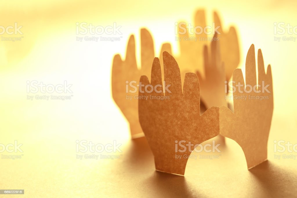 Paper hands in connection stock photo