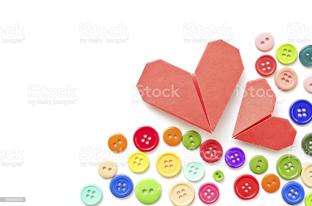 Paper heart and colorful plastic buttons with copy space royalty-free stock photo