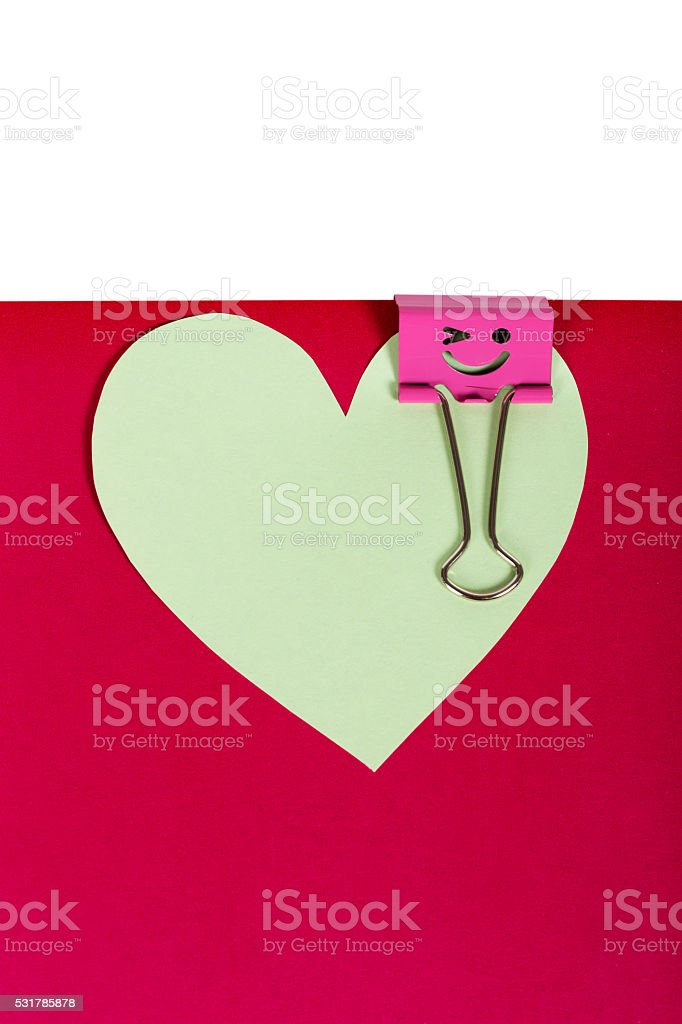Paper heart pinned pink binder with smiley stock photo