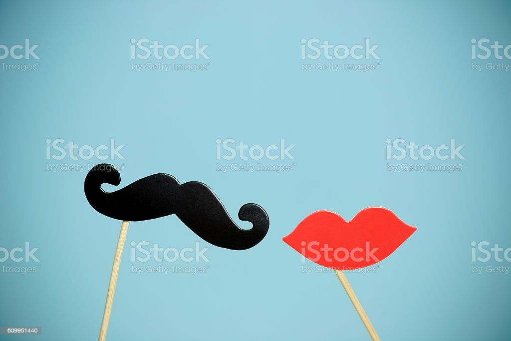 paper heart shape fake lips and mustaches in sticks stock photo