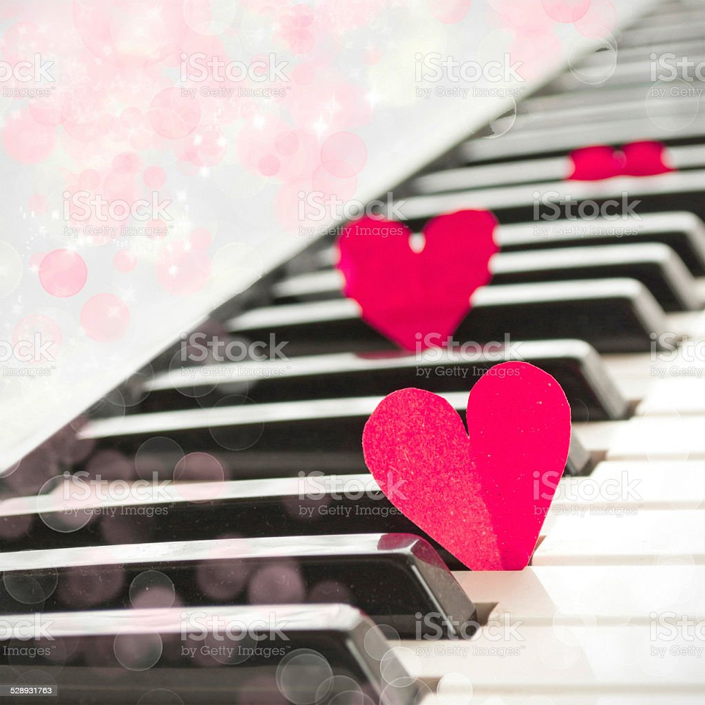 Paper hearts on piano, music love concept stock photo