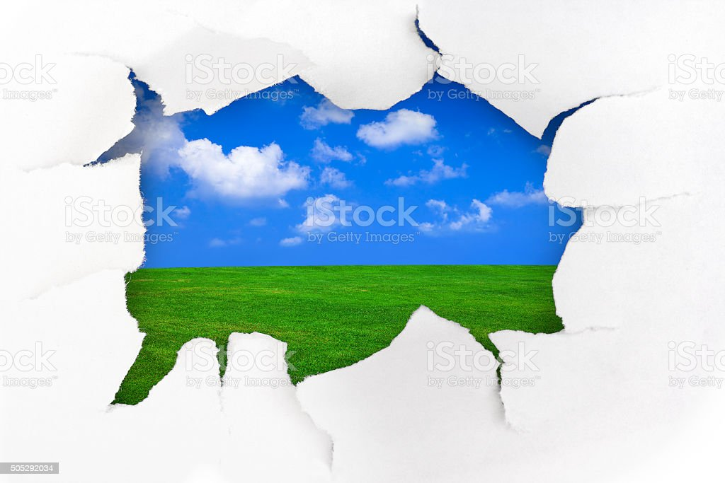 Paper hole and summer landscape stock photo