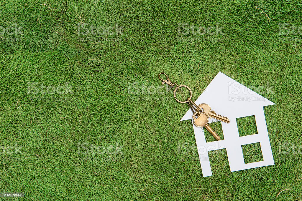 Paper house and key, home environment green living stock photo