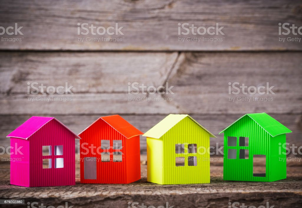 paper house on wooden background stock photo