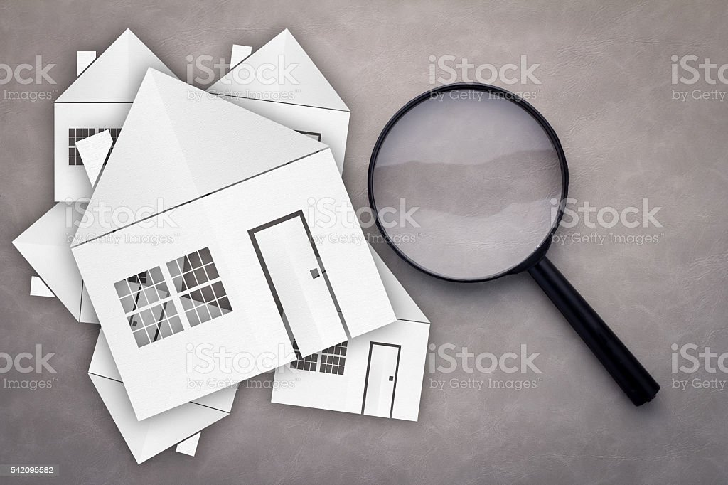 paper house with Magnifying Glass stock photo
