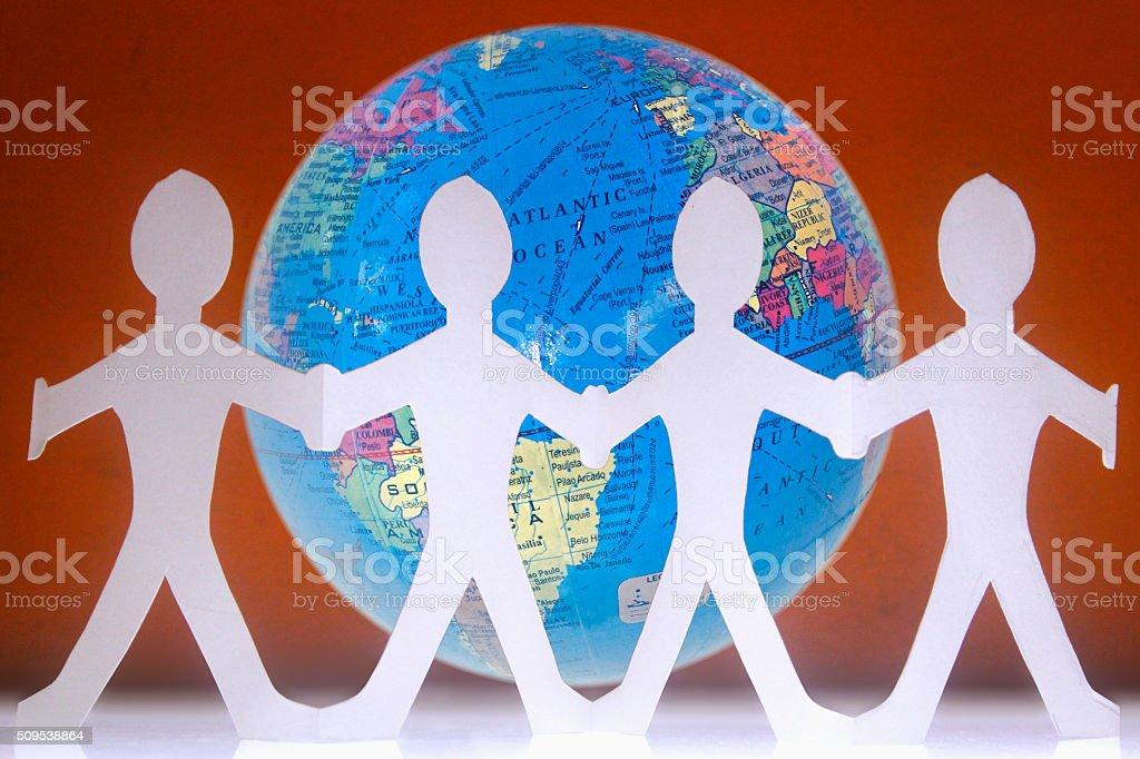 Paper Human around the Globe stock photo