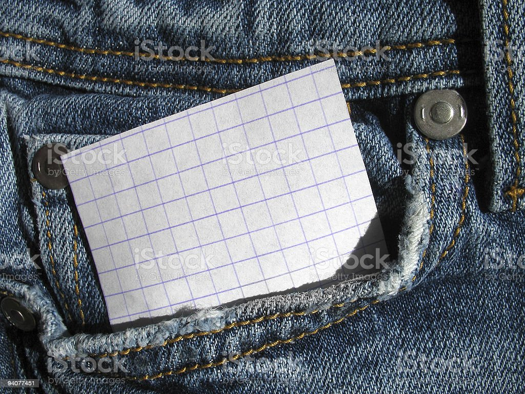 Paper in pocket shabby jeans royalty-free stock photo