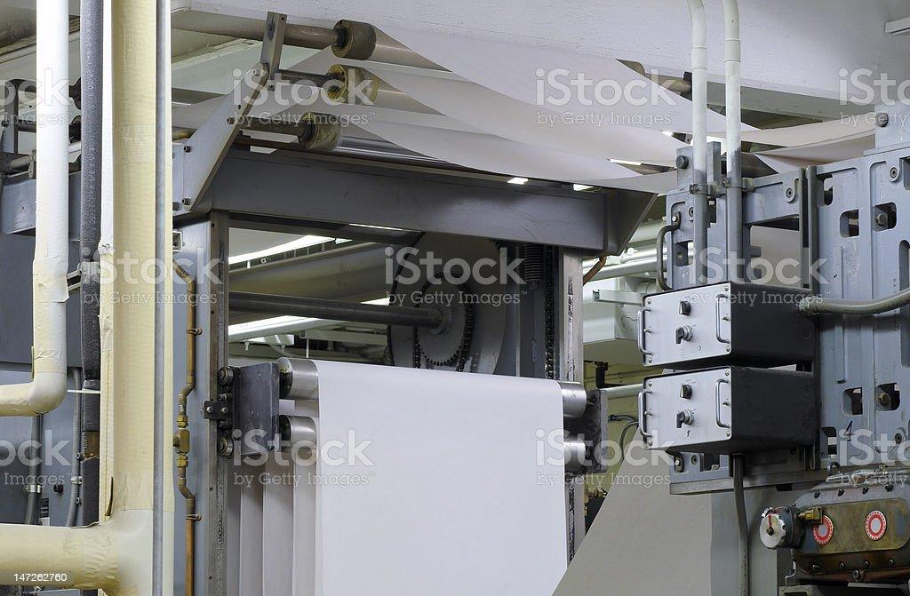 Paper in press stock photo