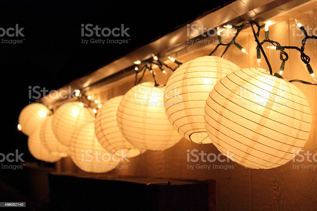 Paper lanters and twinkle lights stock photo