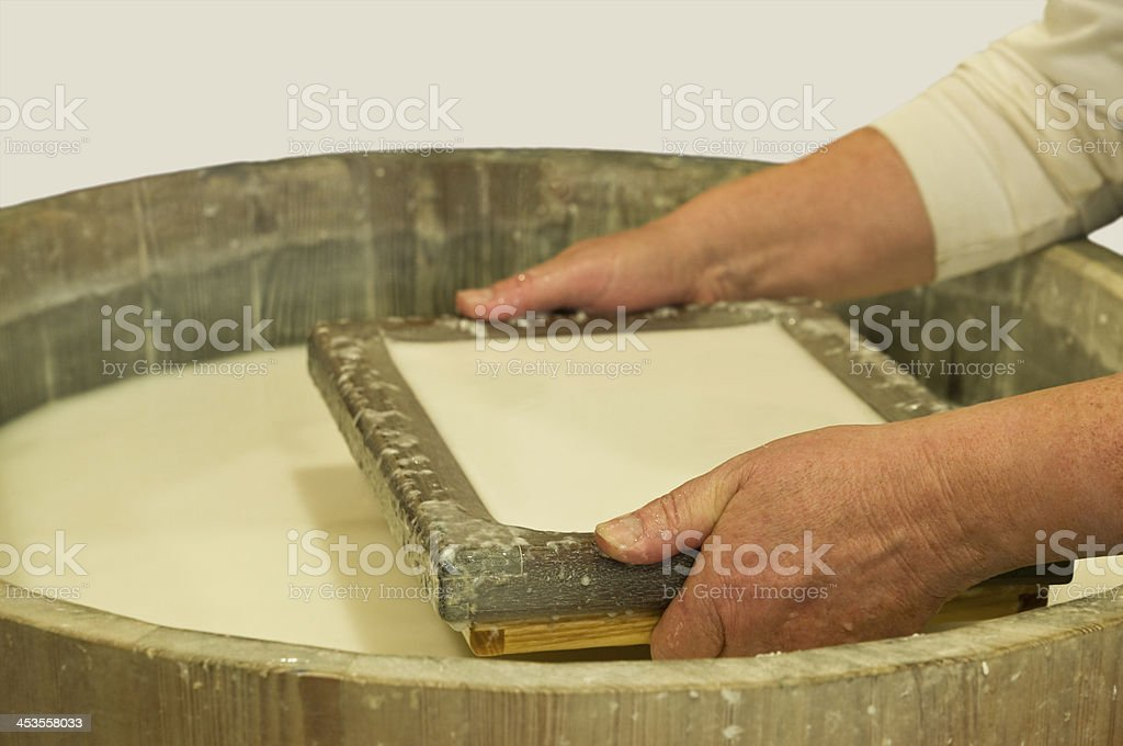 Paper making with cotton through a sieve stock photo