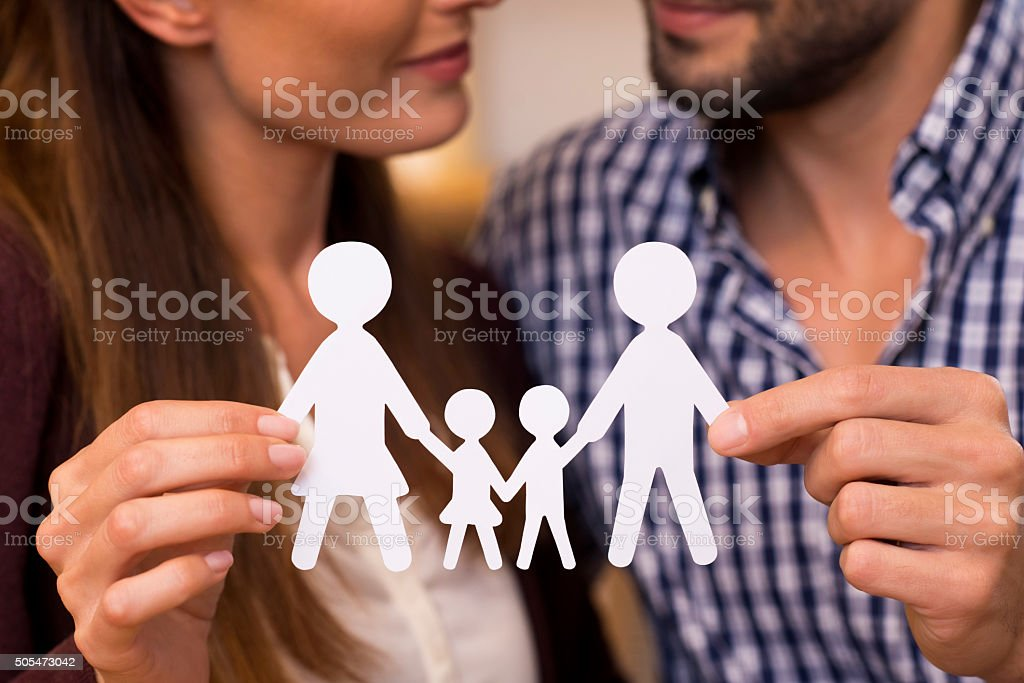 Paper man chain of family stock photo