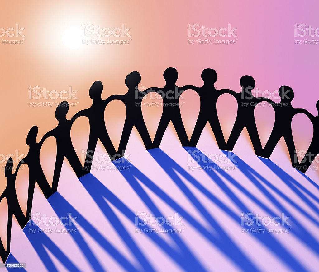 Paper Men Joining Together As Union, Family, Team or Network stock photo