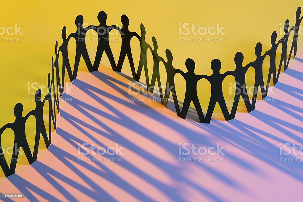 Paper Men Joining Together As Union, Team, Family or Network stock photo