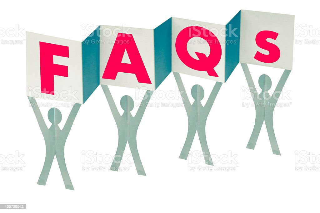 Paper men with flag writing FAQs stock photo