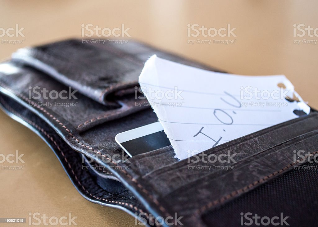 'I.O.U' Paper Message Inside a Leather Wallet stock photo