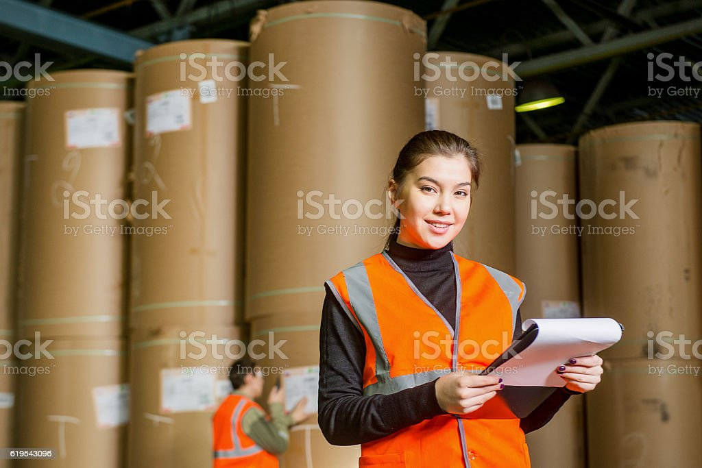Paper mill factory workers stock photo
