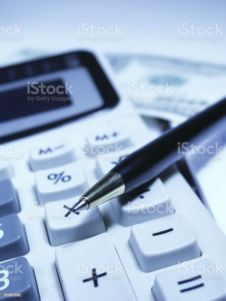 Paper money and a pen and calculator royalty-free stock photo