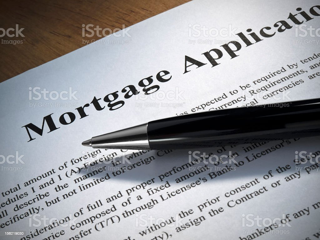 A paper mortgage application with a pen royalty-free stock photo