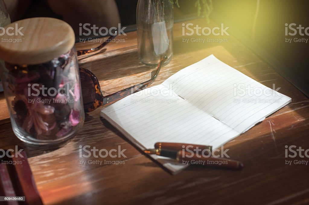 paper note book on the wood table stock photo