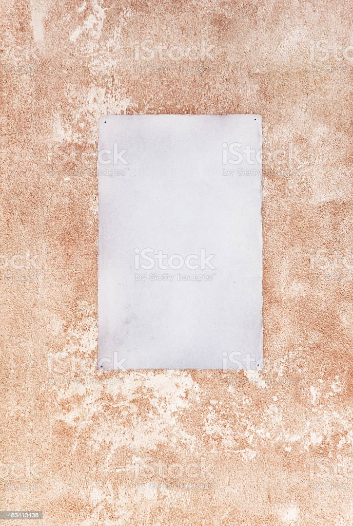 Paper note on a wall stock photo