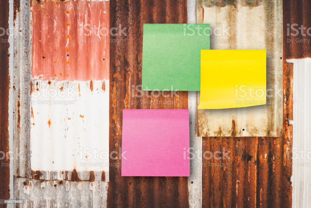 paper note or  stick note on old zinc background stock photo
