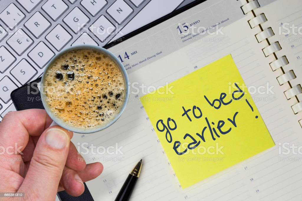 Paper note with the words - Go to bet earlier - in business desk. How to get better concept stock photo