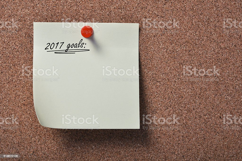 Paper on bulletin board with goals for 2017 stock photo