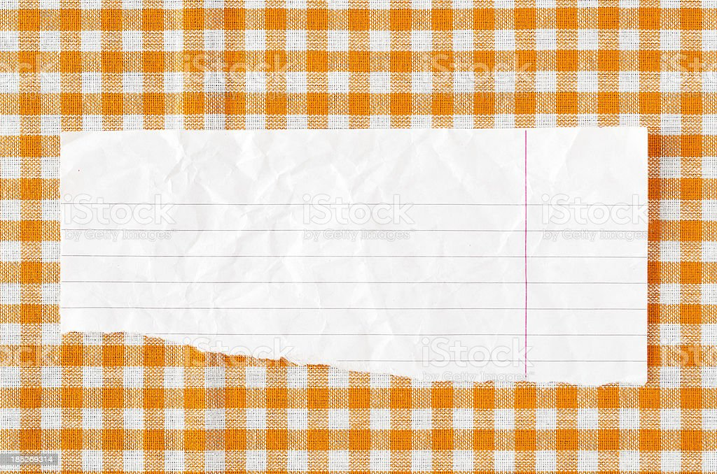 Paper on orange tableclot royalty-free stock photo