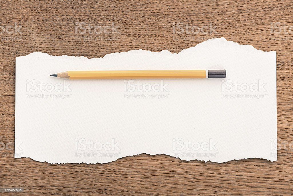 Paper on wooden background royalty-free stock photo