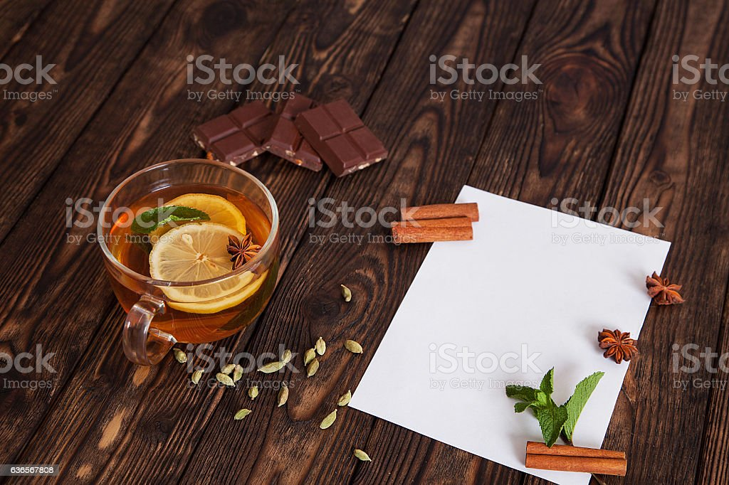 paper on wooden table with a mug of tea royalty-free stock photo