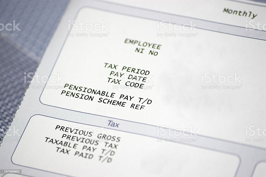 Paper pay slip with tax and pension information stock photo