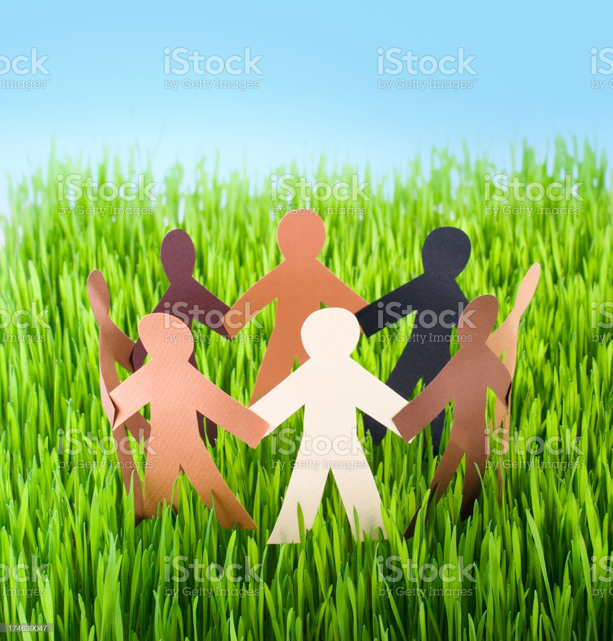 Paper people are on lawn enjoying the sunshine royalty-free stock photo