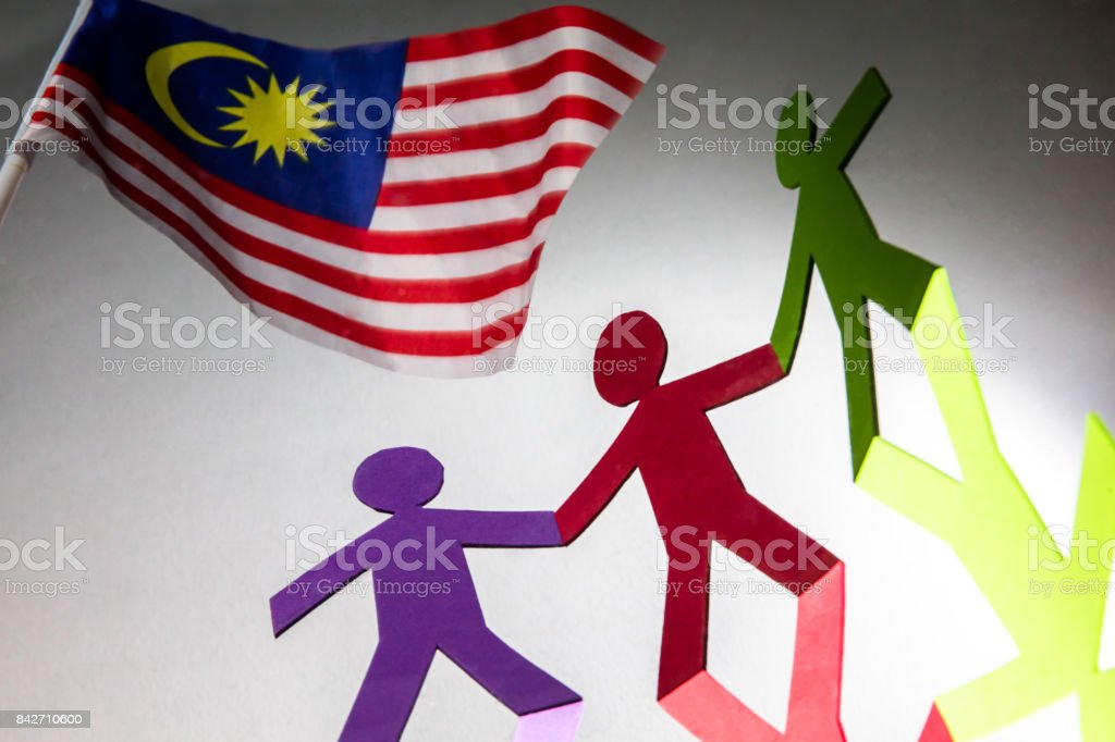 Paper people standing together and holding hands stock photo