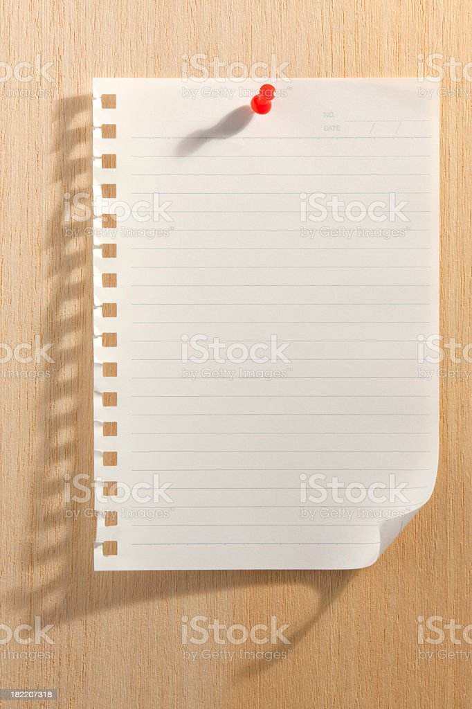 Paper pinned to a wooden pin board. stock photo